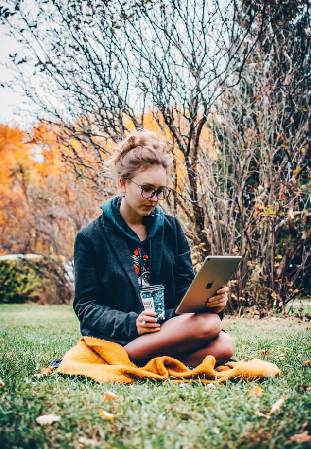Woman Sitting Holding iPad